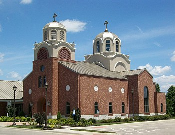 The current church building was constructed in 2006 and is located near College Boulevard and Pflumm Road in Lenexa.